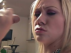 Excited blonde siren Sammy wanking a big schlong on her knees